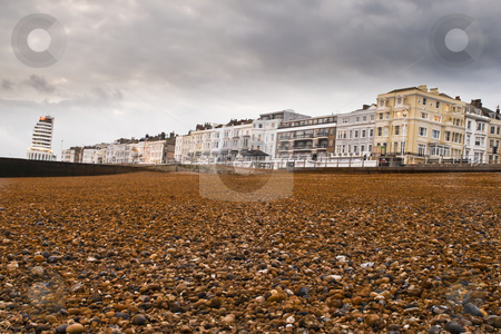 Beach stock photo, Beach in the foreground and houses in the background by Fredrik Elfdahl
