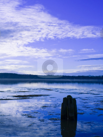 Water and Ice stock photo, Water with a pole and blue sky by Fredrik Elfdahl