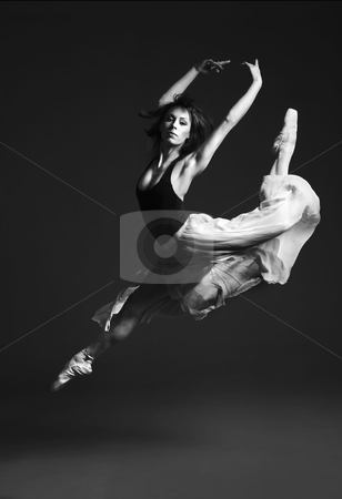 Female Ballet Dancer stock photo, Young female ballet dancer performing on stage. by Rognar