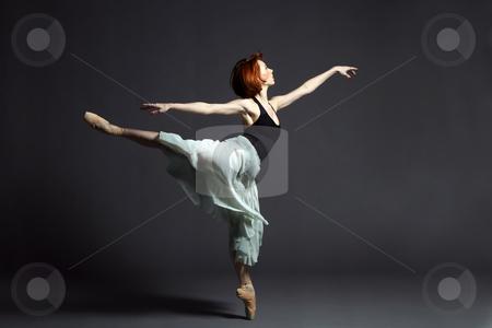 Female Ballet Dancer stock photo, Ballet dancer performing on stage. by Rognar