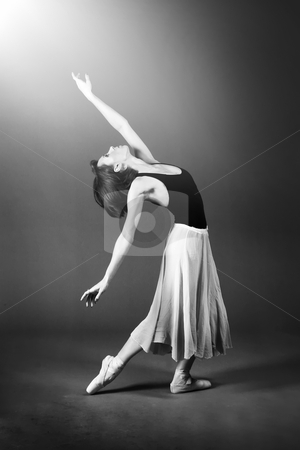 Female Ballet Dancer stock photo, Ballet dancer performing on stage. by Rognar