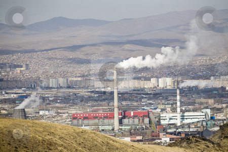 Pollution smoke stock photo, Factory poluting a city with smoke by Mircea Struteanu