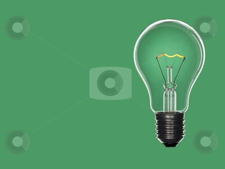 Bulb light over green stock photo, A transparent light bulb over a green background. Tungsten glowing filament. Copy space. by Ignacio Gonzalez Prado