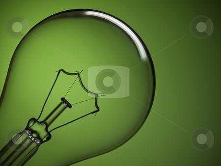 Bulb light over green stock photo, Close up on a transparent light bulb over a green background. by Ignacio Gonzalez Prado