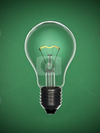 Bulb light over green stock photo, A transparent light bulb over a green background. Tungsten glowing filament. by Ignacio Gonzalez Prado