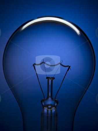 Bulb light on blue stock photo, Close up on a transparent light bulb over a blue background. by Ignacio Gonzalez Prado