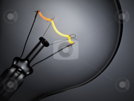 Bulb light over grey stock photo, Close up on a turned on light bulb over a grey background. by Ignacio Gonzalez Prado