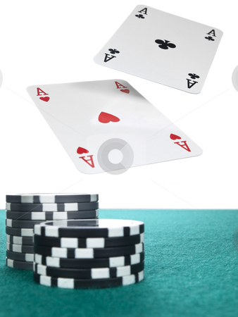 Flying aces stock photo, Two aces flying over a stack of chips on the poker table. by Ignacio Gonzalez Prado