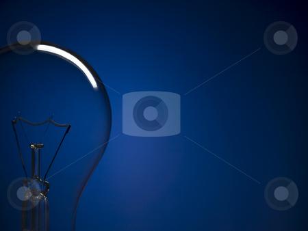 Bulb light over blue stock photo, Close up on a transparent light bulb over a blue background. Copy space. by Ignacio Gonzalez Prado