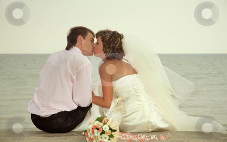 Kiss   stock photo, Day of wedding the most solemn and unforgettable in a life of each person. by Sergey Goruppa