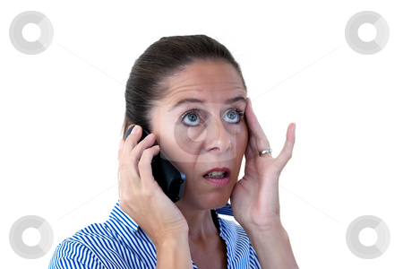 Middle Aged Business Woman Looking Shocked on the Phone stock photo, Middle aged business woman on the telephone looking shocked on a white background by Keith Wilson