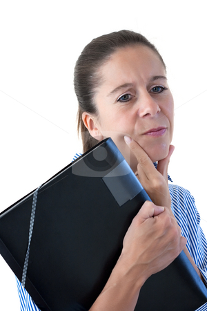 Middle Aged Business Woman Looking Thoughtful with File stock photo, Middle aged business woman looking thoughtful holding a black file on a white background by Keith Wilson