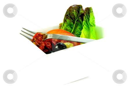 Olive Salad and Fork stock photo, Sun dried tomato, sliced tomatoes, lettace with green and black olives and small fork in a bowl on a white background by Keith Wilson