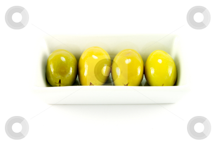 Four Green Olives in a Dish stock photo, Four green olives in a small dish on a white background by Keith Wilson