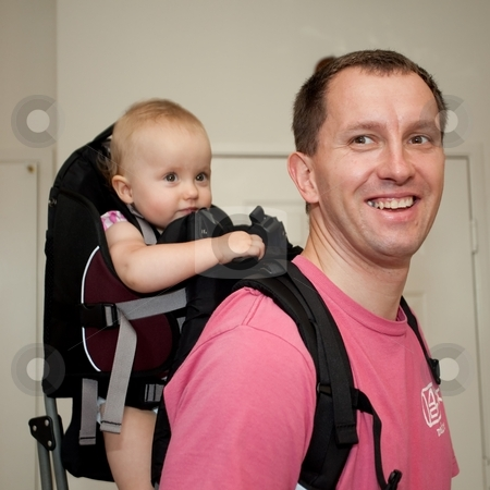 Child carrier stock photo, Child carrier is a device used to carry an infant or small child on the body of an adult. by Mariusz Jurgielewicz