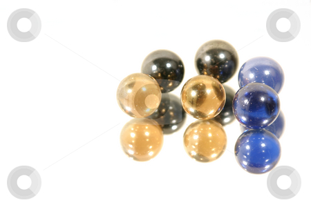 Marbles on Mirror stock photo, Isolated Marbles on Mirror by Mehmet Dilsiz