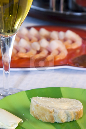 Shrimps on a Plate with the Wine Glass and Sliced Bread in Focus stock photo, Close up - Shrimps on a Plate with the Wine Glass and Sliced Bread in Focus by Mehmet Dilsiz