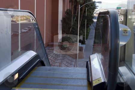Escalators going down to the street in Las Vegas stock photo, Escalators going down to the street in Las Vegas with the city in the background by Mehmet Dilsiz