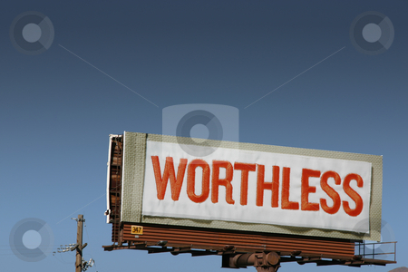 Worthless - Billboard Sign stock photo, Close up on a billboard sign with WORTHLESS text by Mehmet Dilsiz