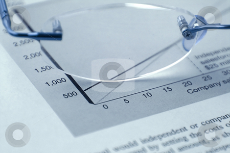 Glasses and the Budget stock photo, Glasses and the Budget Reports by Mehmet Dilsiz
