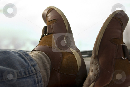 Feet on the Dashboard Relaxing stock photo, Feet on the dashboard relaxing during lunch by Mehmet Dilsiz