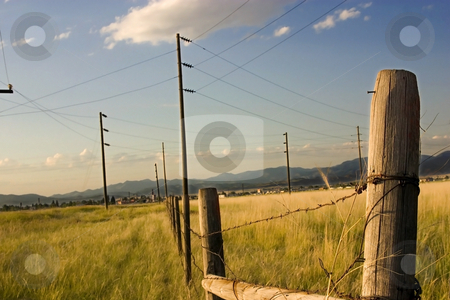 Fence in the Field with Blue Background stock photo, Fence in the Field with Blue Background in Helena Montana by Mehmet Dilsiz