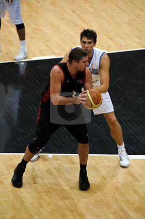 FIBA Trentino Cup: Italy vs Canada stock photo, Game 2 of FIBA Trentino Cup: Italy vs Canada. The tournament was played in Trento (Italy) between the 25th and the 27th of July 2009. Italian player Andrea Bargnani defending on the Canadian forward. Photo taken on the 25th of July, 2009 by Alessandro Rizzolli