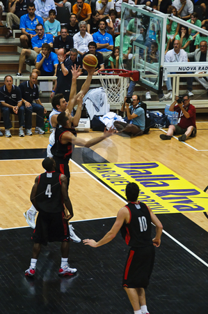 FIBA Trentino Cup: Italy vs Canada stock photo, Game 1 of FIBA Trentino Cup: Portugal vs New Zealand. The tournament was played in Trento (Italy) between the 25th and the 27th of July 2009. Andrea Bargnani driving to the basket with a Canadian defender trying to block him. Photo taken on the 25th of July, 2009. by Alessandro Rizzolli