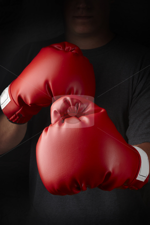 Knockout stock photo, Boxer with red boxing gloves about to throw a punch by James Barber