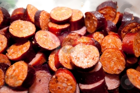 Chorizo al vino stock photo, Chorizo is a term encompassing several types of pork sausage originating from the Iberian Peninsula. by Mariusz Jurgielewicz