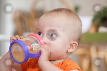 Sippy Cup stock photo, The sippy cup is a spill-proof drinking cup designed for toddlers. by Mariusz Jurgielewicz
