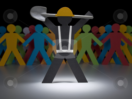 Paper men at work stock photo, A paper construction worker stands under the spotlight with a shovel upon his shoulders. by Ignacio Gonzalez Prado