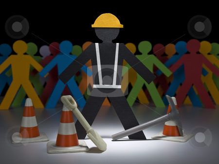 Paper men at work stock photo, A paper construction worker stands on the spotlight with his tools and cones. by Ignacio Gonzalez Prado