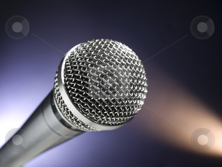 Microphone on stage stock photo, A dynamic microphone on stage. Color spot lights as background. by Ignacio Gonzalez Prado
