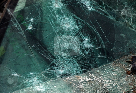 Collision Aftermath stock photo, A shattered auto windshield by Tim Elliott