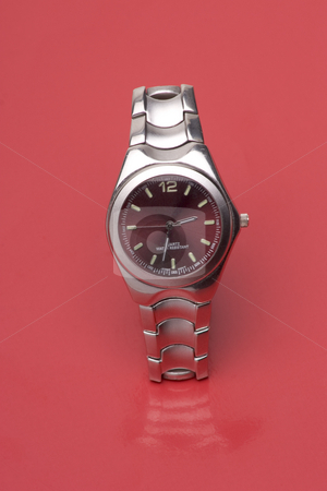 Red watch stock photo, Men sport watch on red reflective surface by Yann Poirier