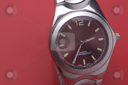 Men sport watch stock photo, Close up of a men sport watch on a red background by Yann Poirier