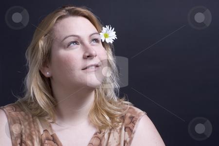 Women thinking about flower stock photo, Women looking up at the heaven thinking about the flower in her hair by Yann Poirier
