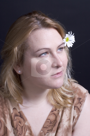 Women thinking stock photo, Women thinking with a daisy in her hair by Yann Poirier