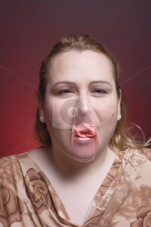 Women burst bubble stock photo, Women with burst bubble gum by Yann Poirier