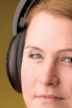 Women with headphone stock photo, Blond hair women with headphone by Yann Poirier
