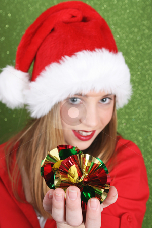 Christmas Teen stock photo, Teenager with red lips wearing a christmas hat. FOCUS ON DECORATIONS by Vanessa Van Rensburg