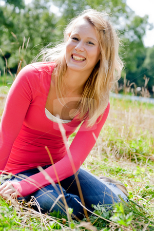 Smiling blond girl stock photo, A blond woman in the park with sunny weather by Frenk and Danielle Kaufmann