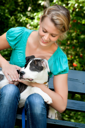 Dog and owner time stock photo, Blond girl and a american bulldog in the park by Frenk and Danielle Kaufmann