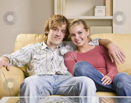 Couple sitting together on sofa stock photo, Couple sitting together on sofa by Jonathan Ross