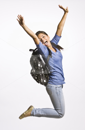 Student wearing backpack jumping stock photo, Student wearing backpack jumping by Jonathan Ross