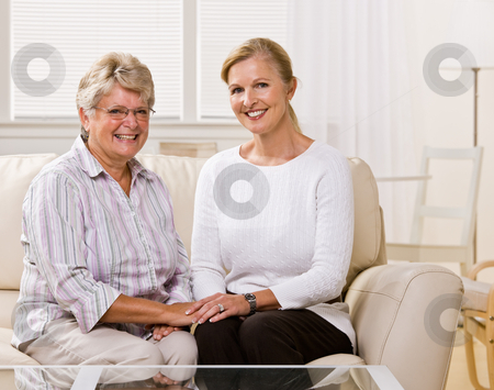 Senior woman sitting with daughter in livingroom stock photo, Senior woman sitting with daughter in livingroom by Jonathan Ross