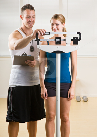 Personal training weight woman in health club stock photo, Personal training weight woman in health club by Jonathan Ross