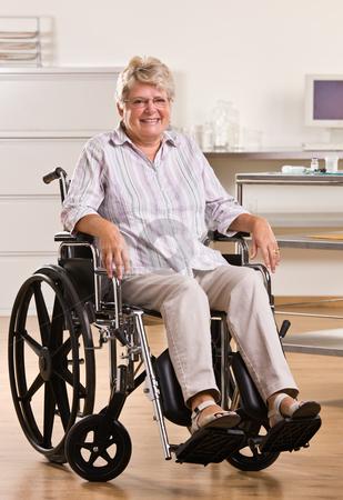 Senior woman sitting in wheelchair stock photo, Senior woman sitting in wheelchair by Jonathan Ross
