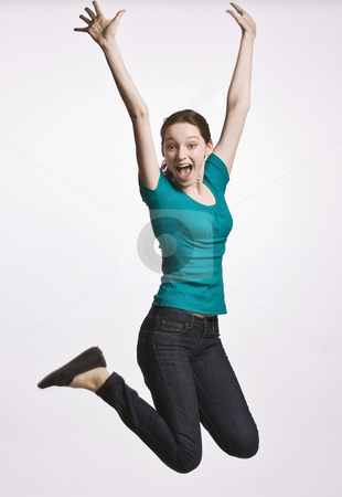 Teenage girl jumping in mid-air stock photo, Teenage girl jumping in mid-air by Jonathan Ross